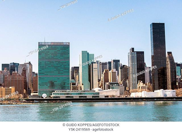 New York, USA. Daytime view on the skyline of Manhattan and the United Nations Head Quarters from Hunters Point, Queens