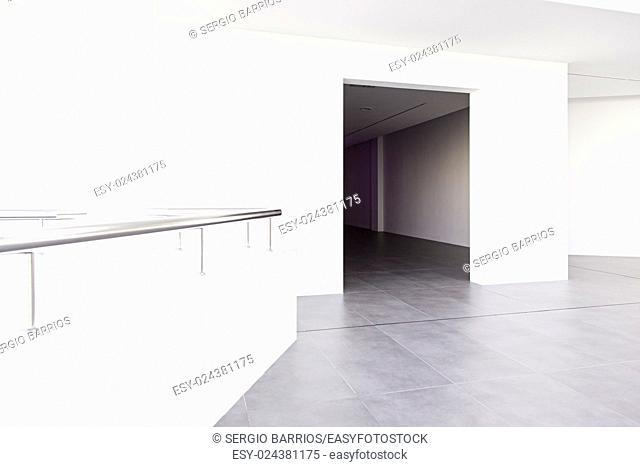 Long walkway and white wall, detail of a hospital corridor