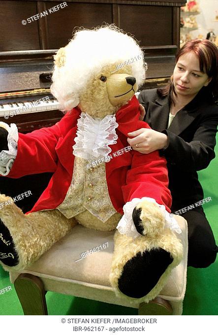Employee of a Coburg toy manufacturer, Hermann-Spielwaren GmbH, arranging an approx. 80 centimeter Mozart teddy bear at the Nuremberg International Toy Fair...
