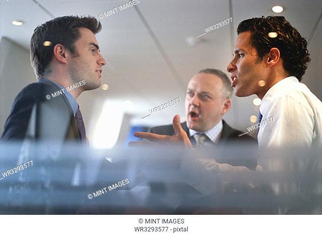 Caucasian businessmen arguing in office