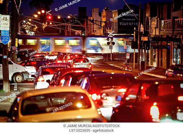 Traffic congestion car wait at railway crossing, evening peak hour, Melbourne Australia