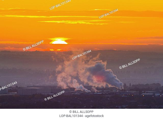 England, Leicestershire, Beaumont Leys. View over Beaumont Leys with steam rising from Pepsico's Walkers Crisps factory on Bursom Road