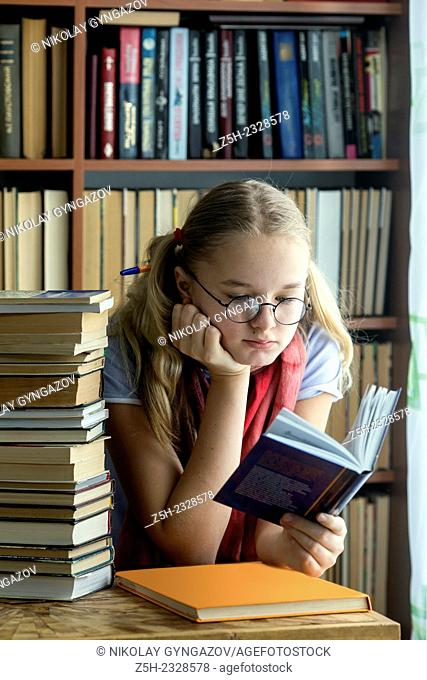 Young girl reading fiction