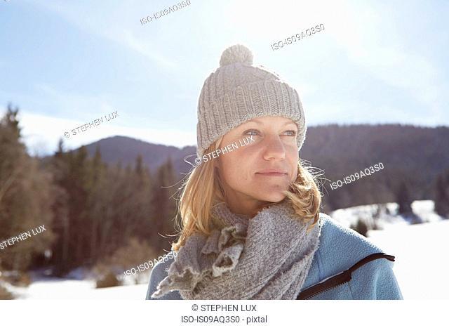 Woman enjoying sun and snow