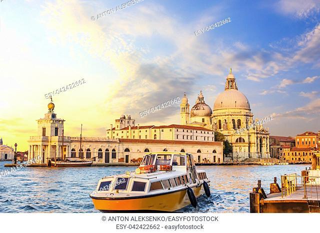 Church of Santa Maria della Salute and the boat near the pier in Venice, Italy