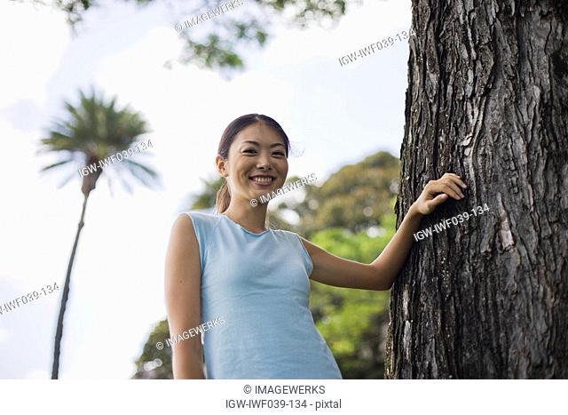 Low angle view of a young woman smiling
