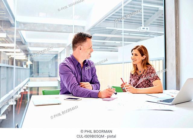 Male and female designers meeting in design studio