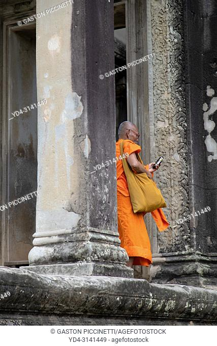 Buddhist monk in Angkor Wat Temple, Angkor Temple Complex, Siem Reap Province, Cambodia, Asia, UNESCO. It was originally constructed as a Hindu temple dedicated...