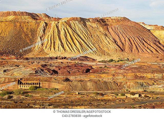 Dramatic landscape of mineral-rich ground and rock, scarred by the open-cast mineworkings of the Rio Tinto mines at the town of Minas de Riotinto