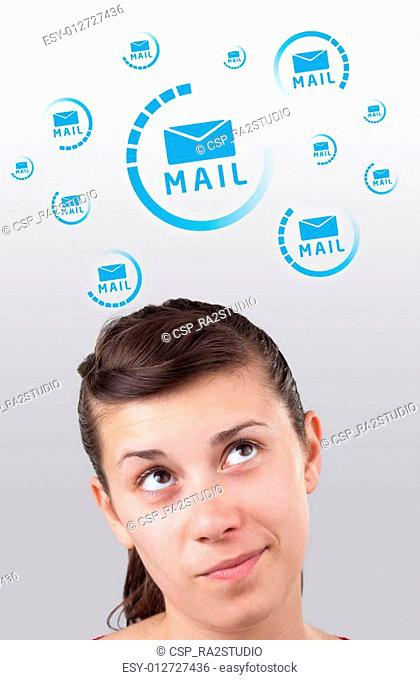 Young girl looking at support contact type of icons and signs