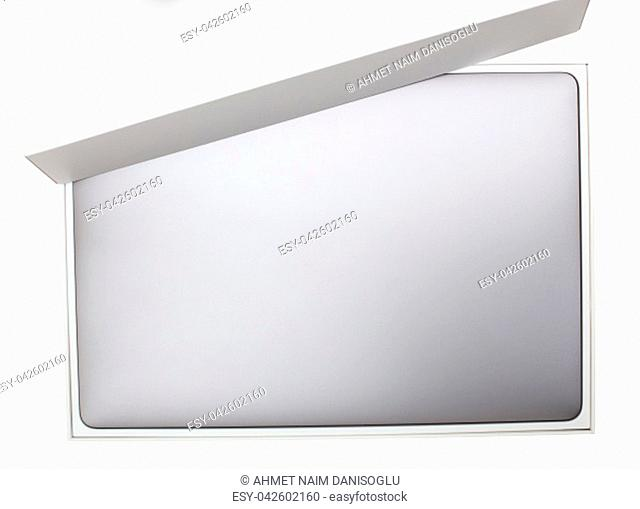 New high-speed thin grey aluminum laptop computer notebook top view with half open box isolated on a white background