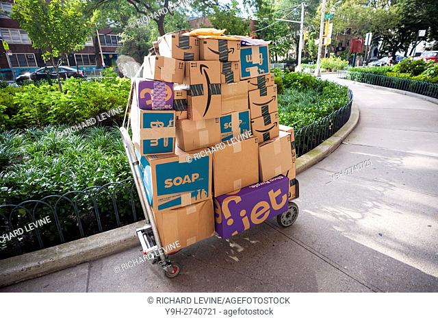 An unattended handcart laden with Jet, Amazon and other deliveries in the New York neighborhood of Chelsea