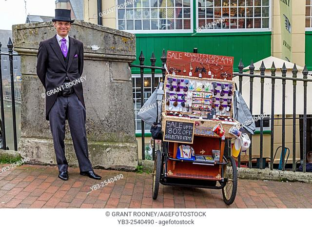 A Well Dressed Man Sells Items From A Mobile Stall, High Street, Lewes, Sussex, UK