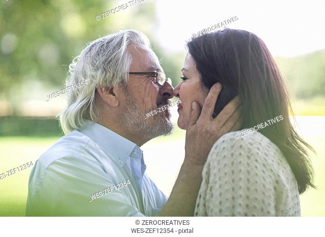 Senior couple kissing outdoors