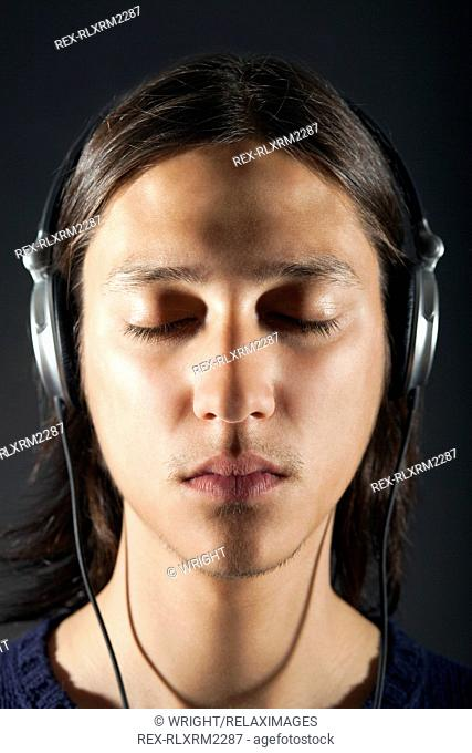 Young man wearing headphones, Munich, Germany