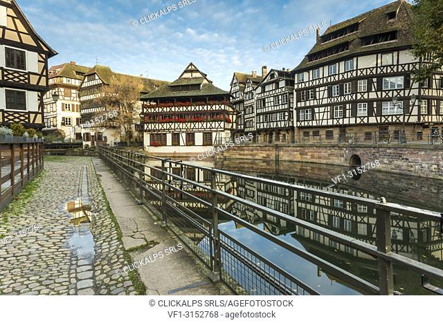 The Maison des Tanneurs on Benjamin Dix square, reflected in the waters of the River Ill, Petit France, Strasbourg district, Alsace, Grand Est region, Bas-Rhin