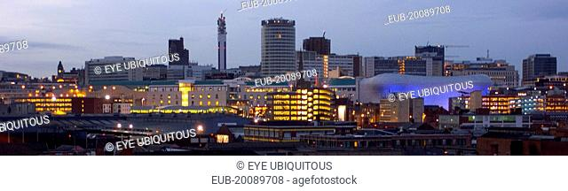 City skyline illuminated in evening light