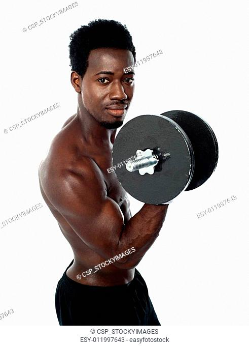 Muscular african guy doing biceps exercise