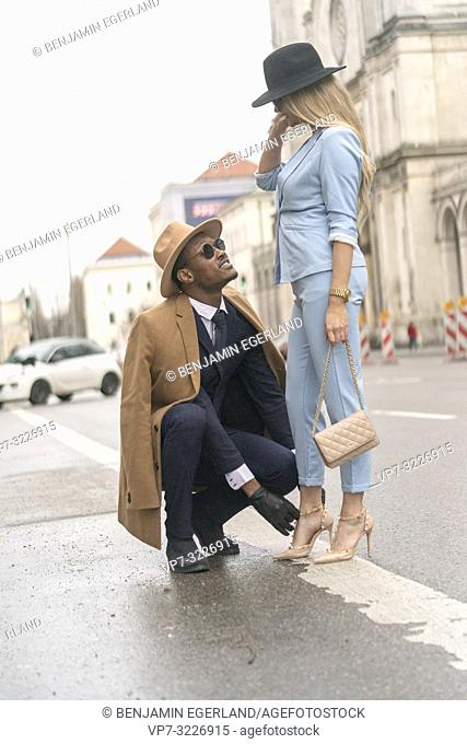 Blogger couple at street, Munich, Germany