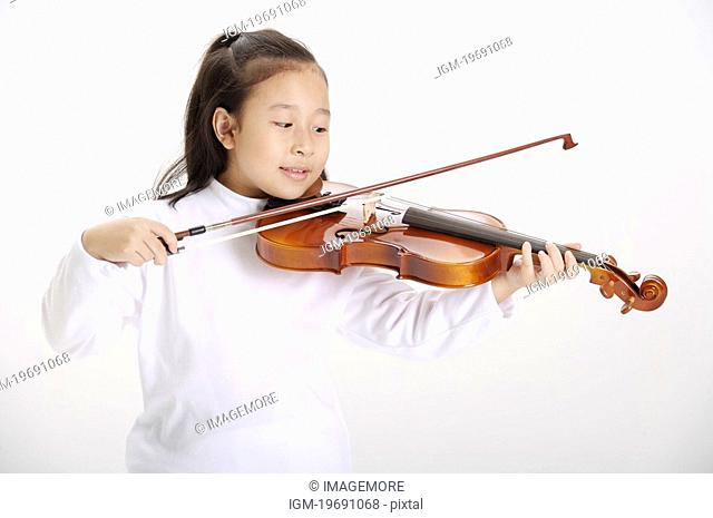 Girl playing violin, smiling
