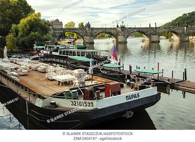 Autumn morning on Vltava river in Prague. Charles Bridge in the distance