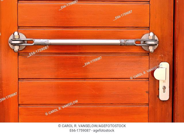 wooden door with silver handle