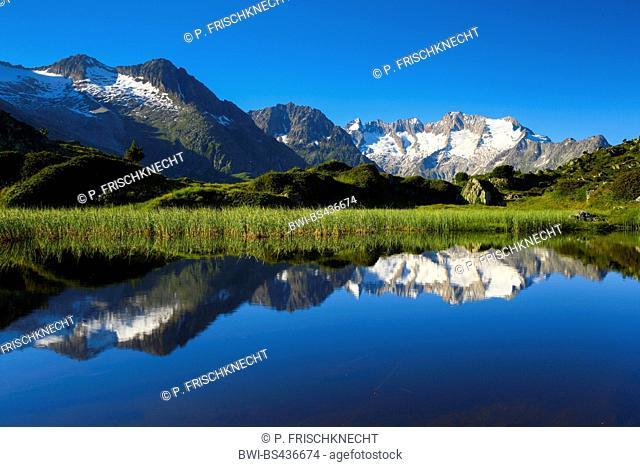 mountains Wannenhoerner reflecting in a mountain lake, Switzerland, Valais