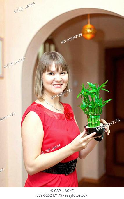 Girl with lucky bamboo plant