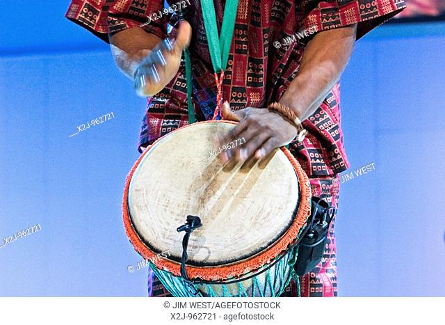 Detroit, Michigan - Members of the Drum Cafe perform during the introduction of new DaimlerChrysler cars at the North American International Auto Show