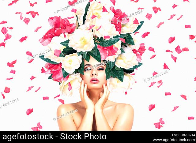 Betautiful young woman face with flower headband. Fashion portrait over white background