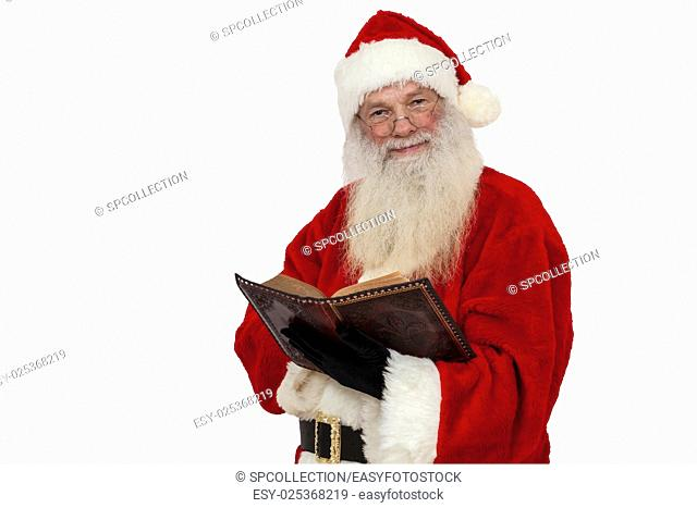 Santa Claus reading in a book (isolated)