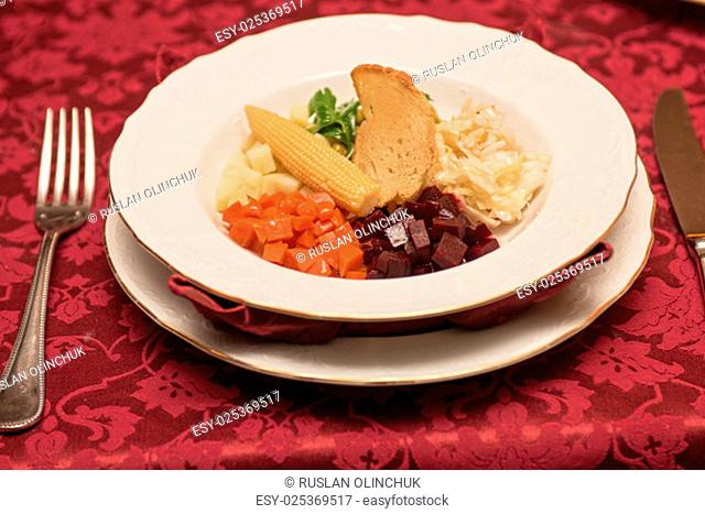 vegetable salad with bread at plate