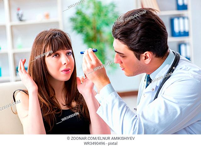 Doctor checking up patient in first aid concept