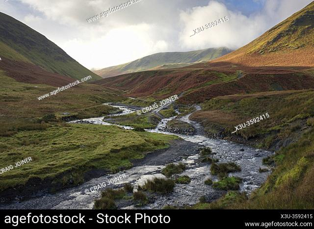 The confluence of the River Glenderamackin and Bullfell Beck with Bannderdale Crags beyond in the Lake District National Park, Cumbria, England