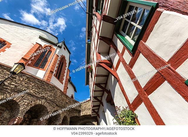 Close up of the parish church St. Martin and a timbered house in Ediger-Eller, Rhineland-Palatinate, Germany, Europe