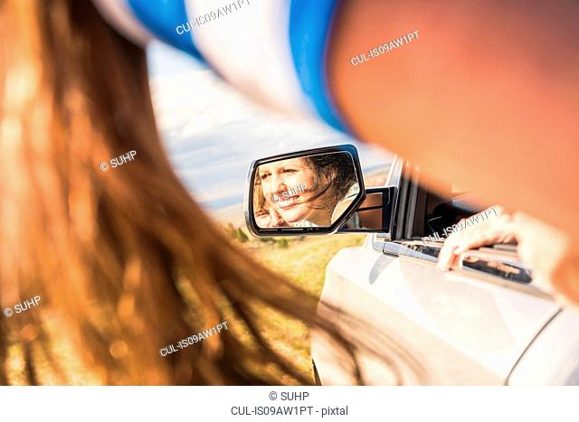 Cropped shot of young woman in off road vehicle mirror