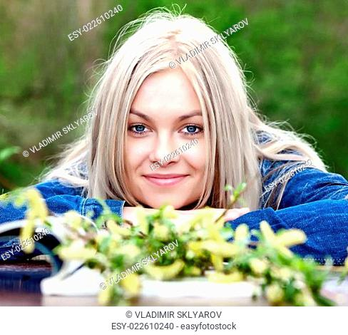 The young blue-eyed blonde in the spring afternoon