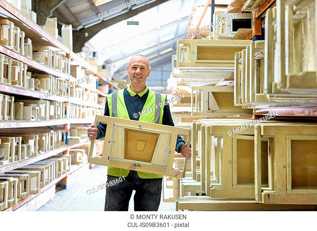 Portrait of manager with stone moulds in architectural stone factory