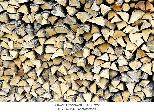 Stack pile of firewood logs for domestic fuel house fire heating