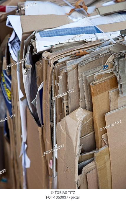 Flattened cardboard boxes tied with twine and ready to be recycled