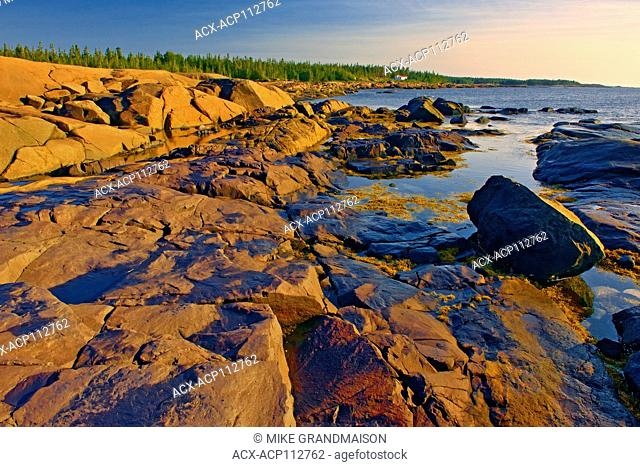 Rocky shoreline on the Gulf of St. Lawrence, Pointe des Monts, Quebec, Canada