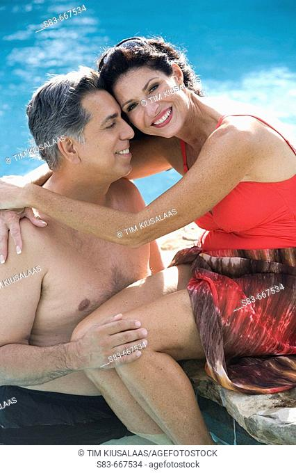 Couple hugging in pool