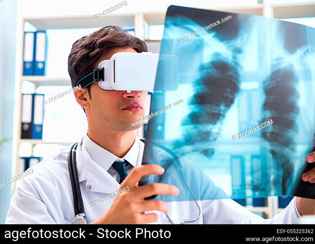 The doctor working with virtual vr reality glasses
