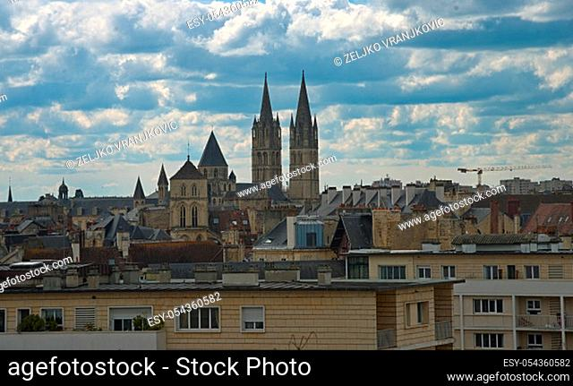 Cityscape of French city Caen with high tower of an catholic cathedral