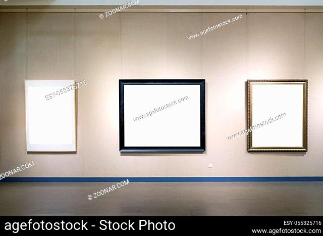 blank picture frames on old wall in a room