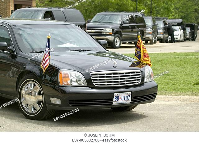 Black Presidential Limo and American Flag and motorcade pulling up in front of Governors Palace in Williamsburg, Virginia on May 4, 2007