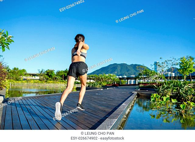 Runner athlete running at park