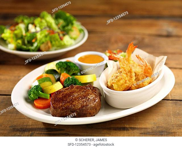 A fillet of beef and shrimps with mixed vegetables (surf and turf)