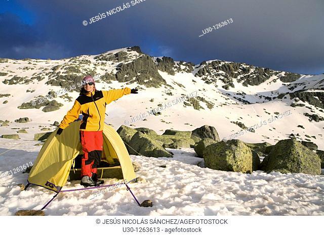 Mountaineer next to the yellow tent in the Sierra de Béjar Natural Park, in Salamanca province, Biosphere Reserve of Sierra de Béjar and Francia