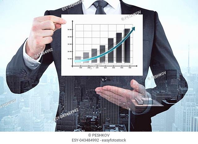 Businessman showing business chart on abstract city background. Presentation and finance concept. Double exposure